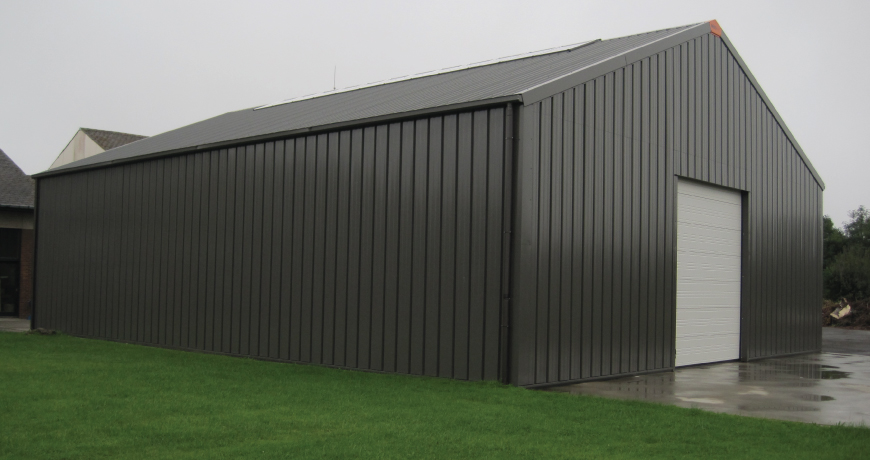 An exterior of a gray Frisomat Metal Hall